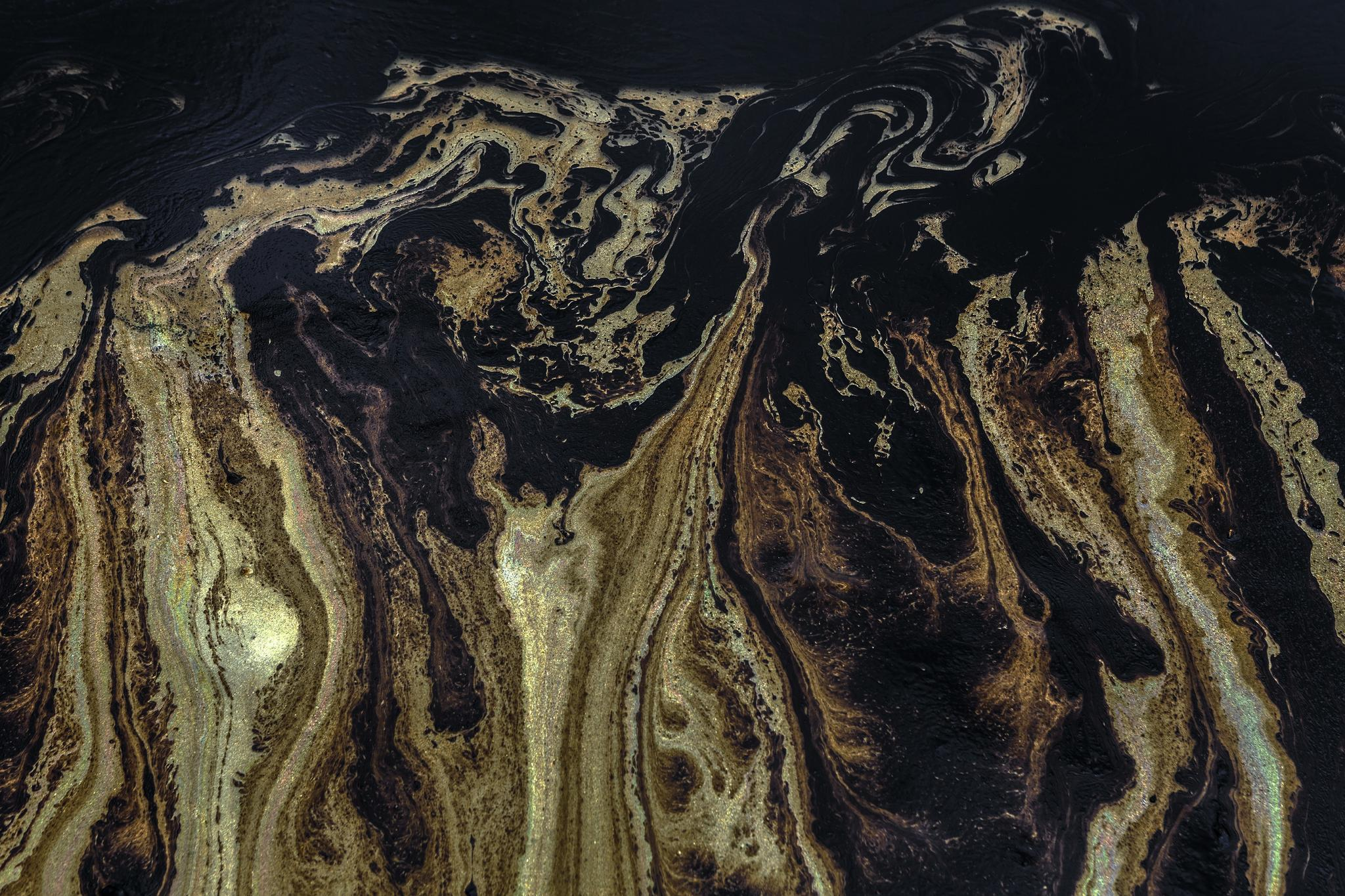 black gold oil slick contamination expo